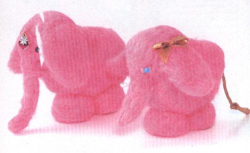 игрушку - розового слона.